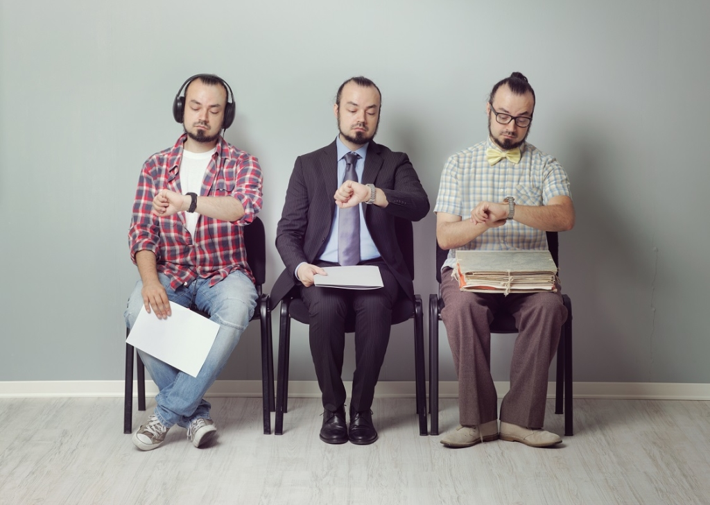 Conceptual image of three men waiting for an interview