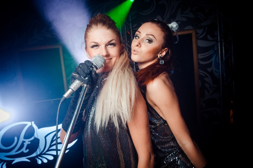 Two girls with microphone. The club