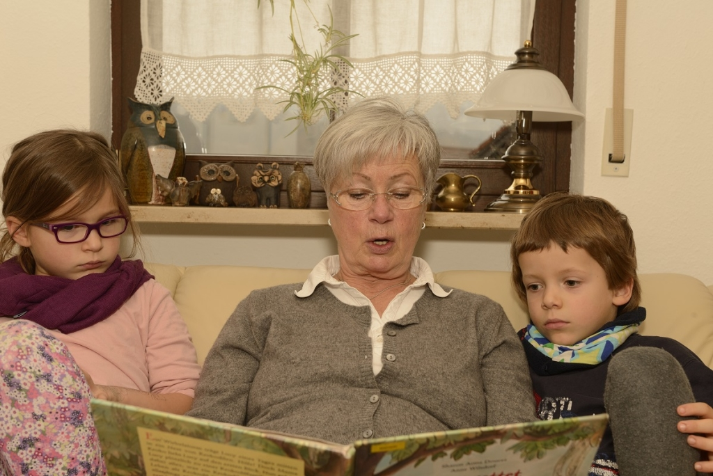 Grandma reading out to Kids
