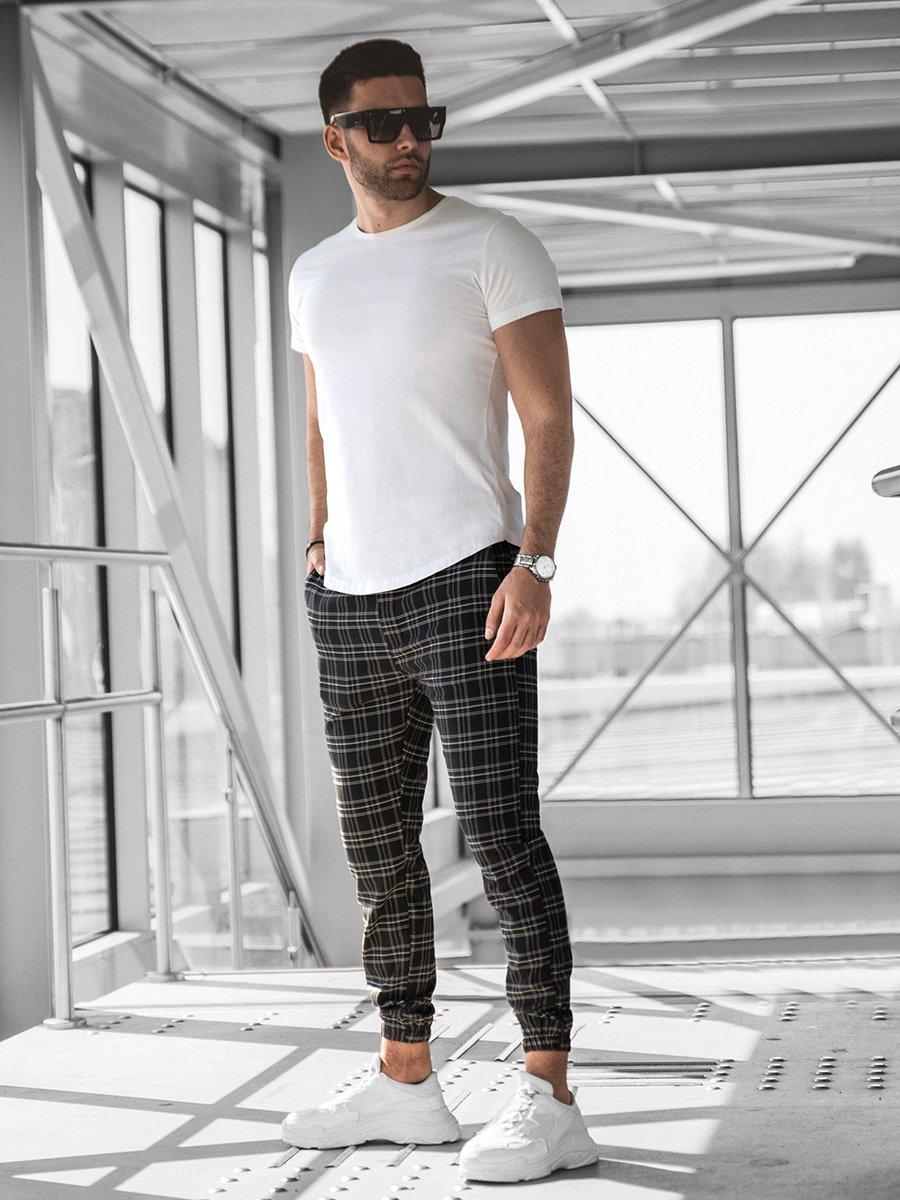 Wysportowany, modnie ubrany mężczyzna